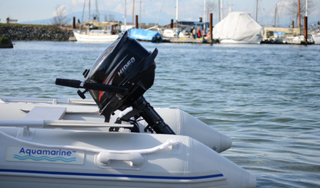 4 hp outboard motor installed on an inflatable boat